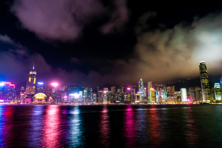 Beautiful architecture building cityscape in Hong Kong city skyline at night and light up Imagens