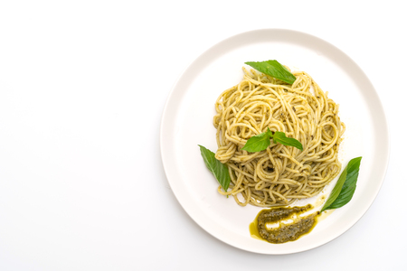 Homamade spaghetti with pesto sauce ,olive oil and basil leaves isolated on white background