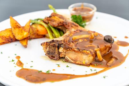pork chop steak with gravy sauce and vegetable Reklamní fotografie