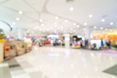 Desenfoque abstracto y centro comercial desenfocado o interior de grandes almacenes para el fondo