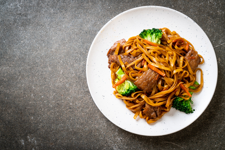 stir-fried noodles with pork and vegetable - Asian food style Stock Photo