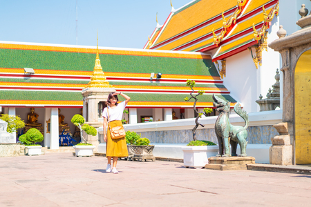 Happy Asian Woman Travel at temple in Thailand