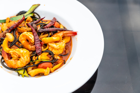 spicy black spaghetti with shrimps (tom yum kung) - fusion food style
