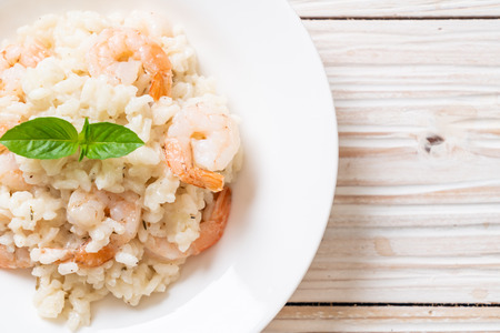 italian risotto with shrimps on white plate