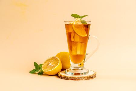glass of ice lemon tea with mint