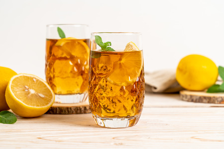 glass of ice lemon tea with mint