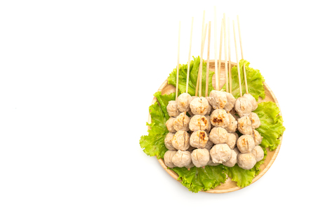 grilled pork meatballs with sweet chili sauce isolated on white background
