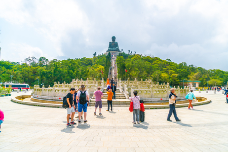 HONG KONG - FEB 21, 2019: Tian Tan Buddha aka the Big Buddha is a large bronze statue of a Sakyamuni Buddha and located at Ngong Ping Lantau Island in Hong Kong.