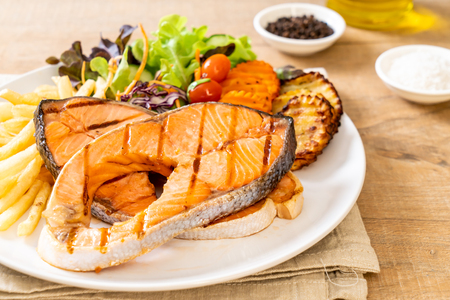 double grilled salmon steak fillet with vegetable and french fries