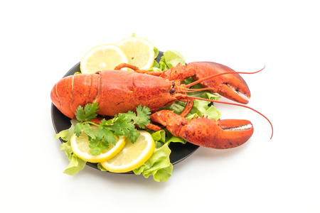 freshly boiled lobster with vegetable and lemon isolated on white background