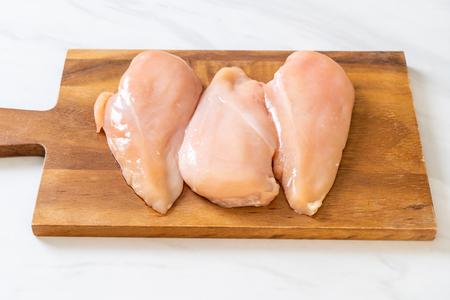 fresh chicken breast raw on cutting board Banco de Imagens