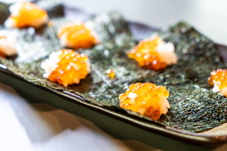 Japanese rice and salmon eggs on seaweed - Japanese food style