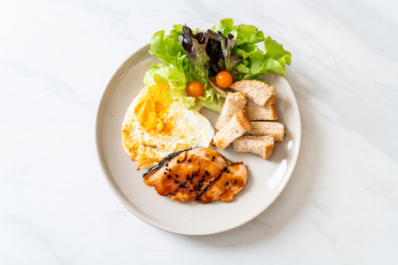 salmon teriyaki steak with fried egg and salad - healthy food style Imagens