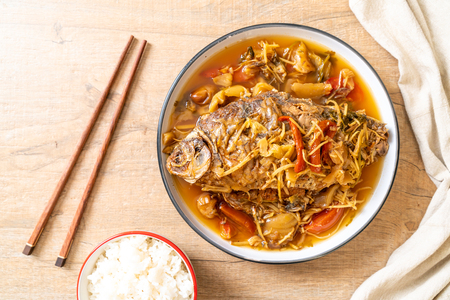 Boiled Carp fish with pickled lettuce - Asian food style