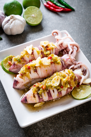 Steamed Squids or Octopus with Spicy Chili and Lemon Lime Sauce