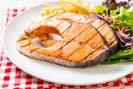 double grilled salmon steak fillet with french fries