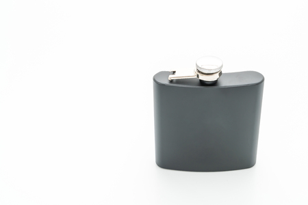 Stainless steel hip flask isolated on white