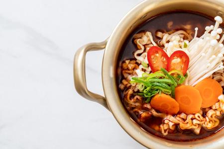 korean instant noodles in golden pot - korean food style