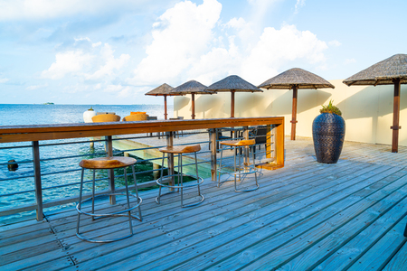 empty outdoor patio deck and chair with blue ocean background in Maldives