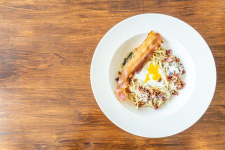 carbonara spaghetti with bacon and egg - Italian food style