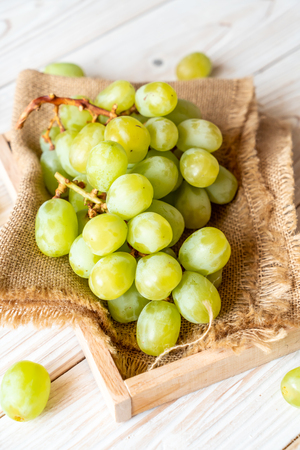 fresh green grapes on wood background Stock Photo