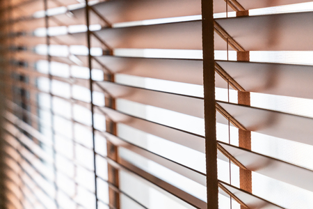 Wooden shutters blind on the window in the living room Stock Photo