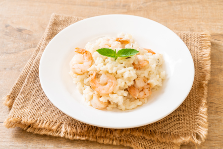 italian risotto with shrimps on white plate Stok Fotoğraf - 124766351