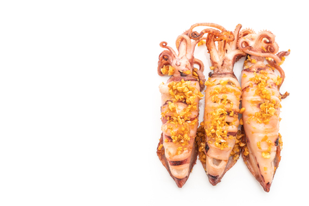 fried squid with garlic isolated on white background Фото со стока