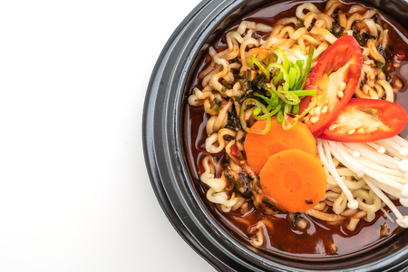 korean instant noodles in black bowl - korean food style isolated on white background Stock Photo