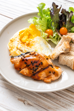 salmon teriyaki steak with fried egg and salad - healthy food style Stock Photo