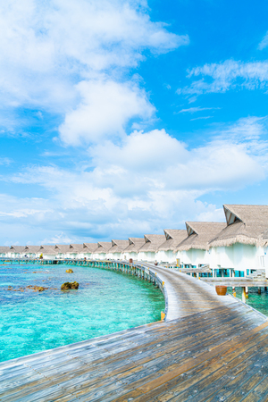 Beautiful tropical Maldives resort hotel and island with beach and sea - holiday vacation background concep Reklamní fotografie
