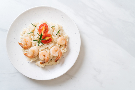 italian risotto with shrimps on white plate Stok Fotoğraf - 124767231