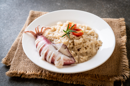homemade squids or octopus risotto Stock Photo
