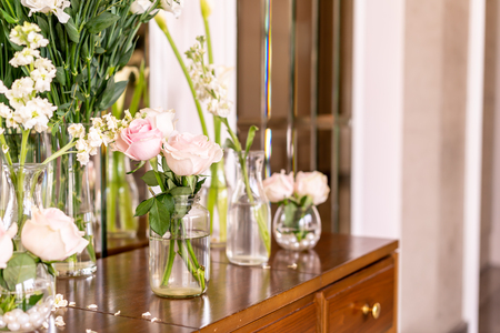 beautiful rose flower in vase decoration on table in a room