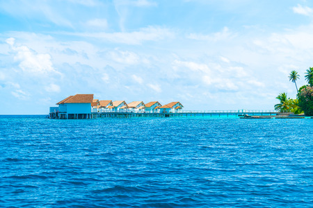 tropical Maldives resort hotel and island with beach and sea for holiday vacation concept - boost up color processing style