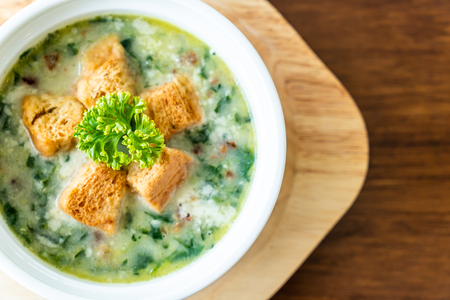 spinach soup with bread in white bowl - healthy and organic food style Imagens