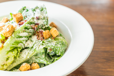 Caesar salad on white plate - Healthy and organic food style