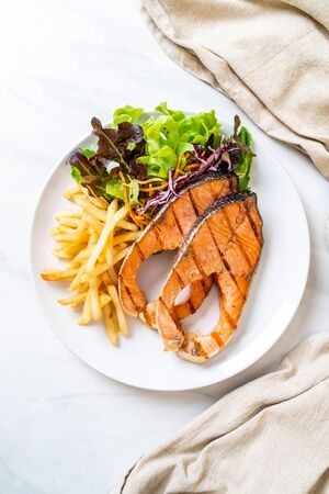 double grilled salmon steak fillet with french fries Фото со стока