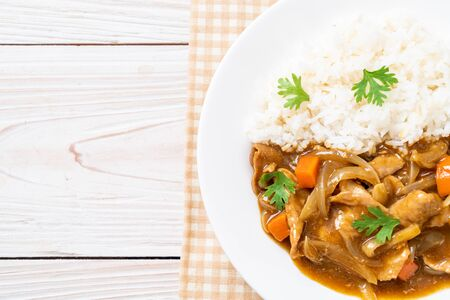 Japanese curry rice with sliced pork, carrot and onions - Asian style Фото со стока