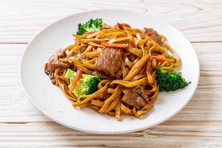 stir-fried noodles with pork and vegetable - Asian food style Фото со стока