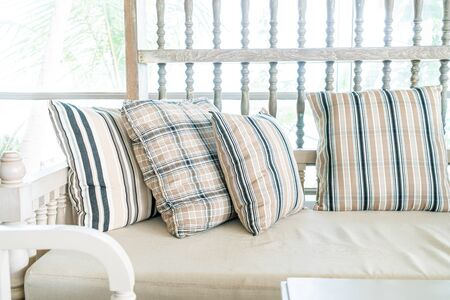 Comfortable pillow on sofa chair decoration interior of room Stock Photo