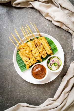 Pork satay - Grilled pork served with peanut sauce or sweet and sour sauce - Asian food style Reklamní fotografie - 124895635