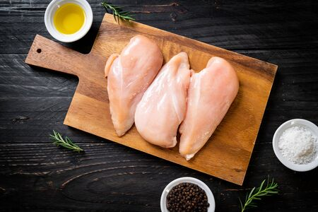 fresh chicken breast raw on cutting board Stock Photo