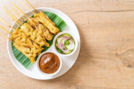 Pork satay - Grilled pork served with peanut sauce or sweet and sour sauce - Asian food style Reklamní fotografie - 124895827