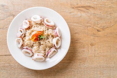 homemade squids or octopus risotto Фото со стока