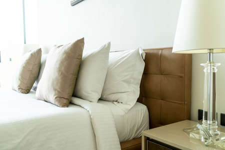beautiful pillow on bed decoration in bedroom interior Stock Photo