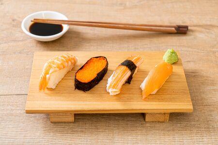 mix sushi set - Japanese food style Reklamní fotografie - 124888844