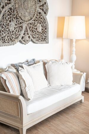comfortable pillows on sofa decoration in living room interior Imagens - 124886088