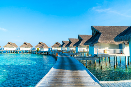 Beautiful tropical Maldives resort hotel and island with beach and sea  - boost up color processing style Editöryel