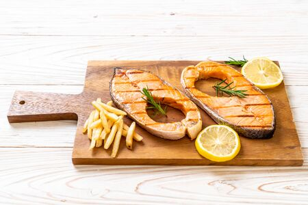 grilled salmon steak fillet with lemon Stock Photo